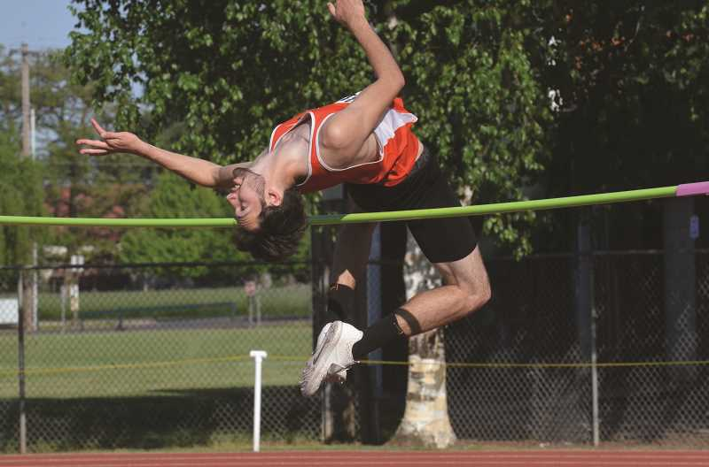 PMG PHOTO: TANNER RUSS - Molalla senior Nick Lucas claimed the top spot in the high jump with a PR 6' leap.