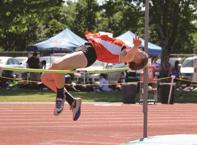 PMG PHOTO: JIM BESEDA - Molalla's Elizabeth 'Lizzy' Grandle took the top spot in the high jump to punch her ticket to state.