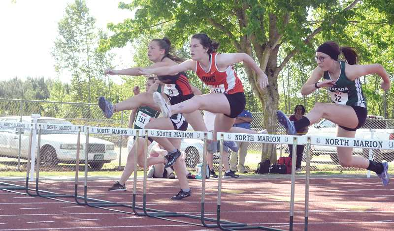 PMG PHOTO: TANNER RUSS - Molalla senior Emma Andrews took first place in the 100-meter hurdles with a time of 16.17 seconds.