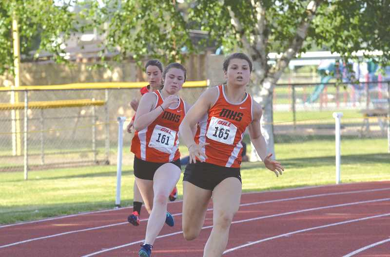 PMG PHOTO: TANNER RUSS - Molalla's Lydia Jeffries-Call and Sarah Phillips were a part of the 4x100-meter relay team that snagged second place, and got to the state meet.