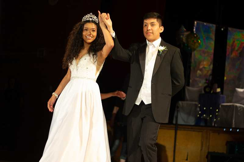 JONATHAN VILLAGOMEZ - May Day Queen Odalis Bedolla was escorted by Jason Cano-Morales.