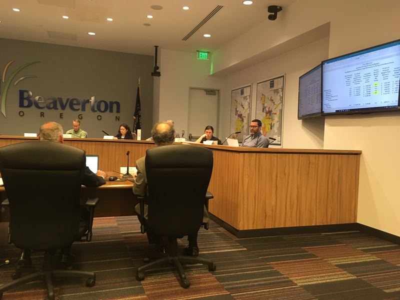PMG PHOTO BY PETER WONG - Finance Director Patrick O'Claire, seated at left, and Assistant Finance Director Dave Waffle explain trends to the Beaverton City Budget Committee at a meeting Monday, May 13. The committee expects to recommend a budget on May 23.