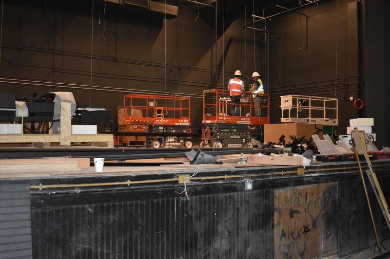 PMG PHOTO: TERESA CARSON - Specialsts install the rigging in the new theaters stage. The new auditorium will be ready for Barlows fall music and theater performances.