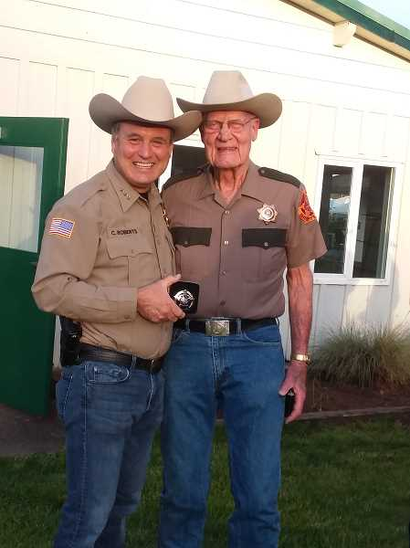 COURTESY PHOTO: CATHY RAE SMITH - Clackamas County Sheriff Craig Roberts & Vern Hulit, Clackamas County Sheriff's Posse longest standing member. Since 1958, he has served as captain twice, first lieutenant four times, second lieutenant about seven times, is currently a director and has been on the board about a decade.