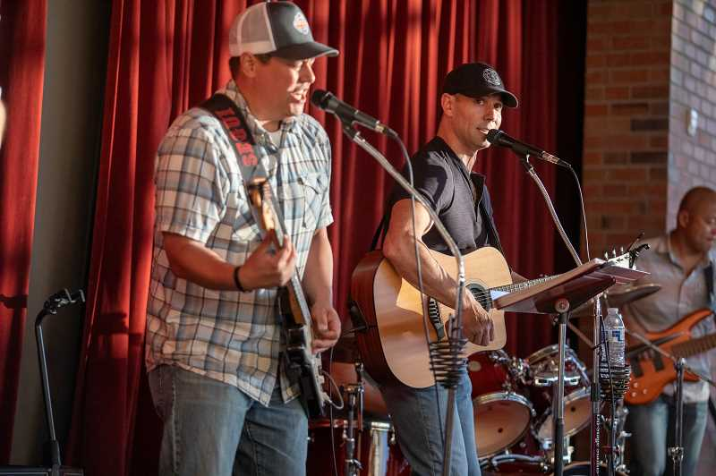 PMG PHOTO: JONATHAN HOUSE - Rich Neighorn, left, and Jason Segui perform as part of the Fifth Alarm Band at the Villebois benefit.