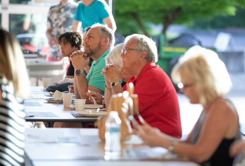 PMG PHOTO: JONATHAN HOUSE - The crowd enjoys breakfast for dinner and music at the Villebois fundraiser.