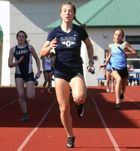 PMG PHOTO: TANNER RUSS - Lake Oswego senior Maddie DeBorde holds the top marks in the Three Rivers League in both the 100 meters and long jump; she'll compete in the TRL district meet at Oregon City on Wednesday and Friday.