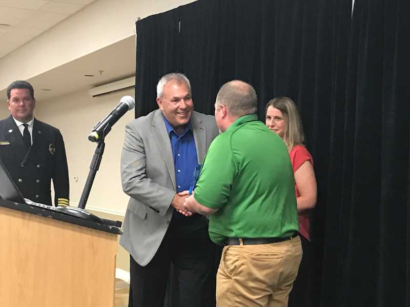 COURTESY PHOTO - Dan Rossos receives an award for his dedication to fire safety during the Oregon Fire Chiefs Association annual conference.
