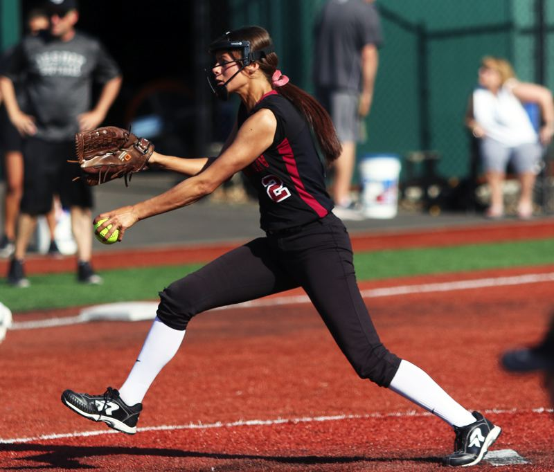 PMG PHOTO: DAN BROOD - Tualatin High School junior Tia Ridings gets ready to fire in a pitch during the Timberwolves' non-league game at Jesuit.