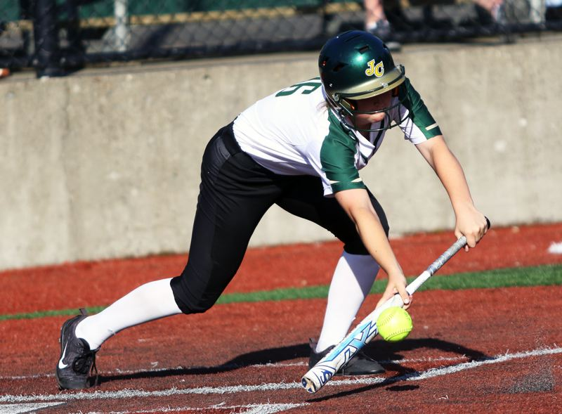 PMG PHOTO: DAN BROOD - Jesuit High School freshman Hannah Brink puts down a bunt during the Crusaders' 5-3 win over Tualatin on Friday.
