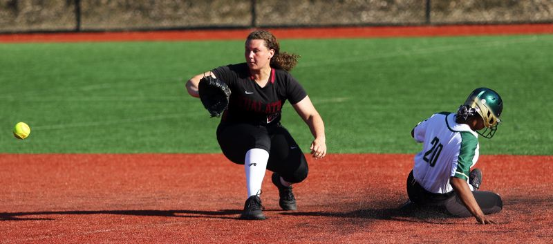 PMG PHOTO: DAN BROOD - Tualatin senior shortstop Emily Johansen (left) looks to make a catch as Jesuit's Maya Williams slides to second base during Friday's non-league game.