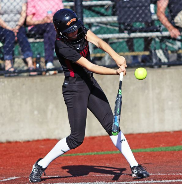 PMG PHOTO: DAN BROOD - Tualatin High School junior Sydney Wagner gets her bat on the ball during the Timberwolves' game at Jesuit on Friday.