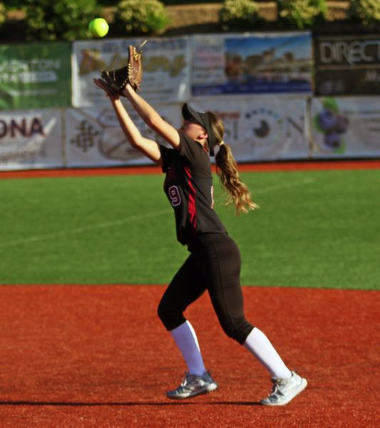 PMG PHOTO: DAN BROOD - Tualatin High School senior second baseman Andrea Gomez gets under a fly ball during the Timberwolves' game at Jesuit on Friday.