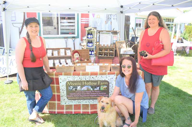 PMG PHOTO: EMILY LINDSTRAND - Organizers of the Estacada Farmers Market stand at the Mystic Hollow Farm booth on Saturday, May 11.