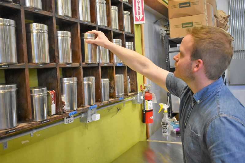 PMG PHOTO: EMILY LINDSTRAND - Seth OMalley, head distiller at Townshend's, looks through the distillerys collection of 150 botanical ingredients.