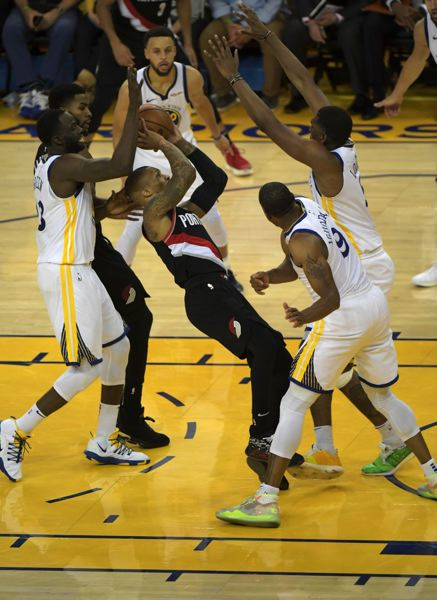 COURTESY PHOTO: GEROME WRIGHT - The Golden State Warriors converge on Damian Lillard of the Trail Blazers during Tuesday night's series opener at Oakland, California.