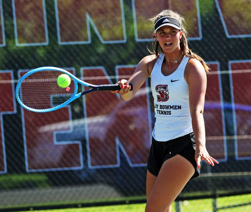 PMG PHOTO: DAN BROOD - Sherwood High School freshman Mandie Jensen hits a forehand shot during the girls doubles title match at the Pacific Conference district tournament.
