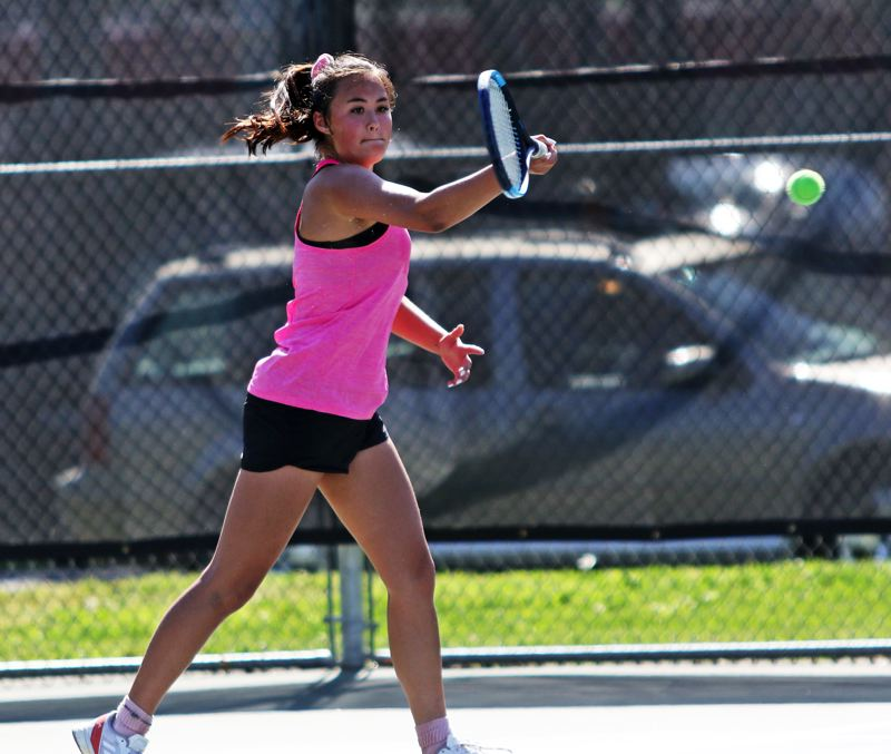 PMG PHOTO: DAN BROOD - Sherwood High School senior Kolleen Peters took fourth place in girls singles play at the Pacific Conference district tennis tournament.
