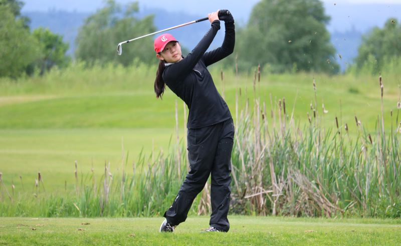PMG PHOTO: JIM BESEDA - Clackamas' Hannah Lim watches her tee shot at the 125-yard, par-3 16th hole during Tuesday's  final round of the OSAA Class 6A girls golf state championships at Quail Valley Golf Course.