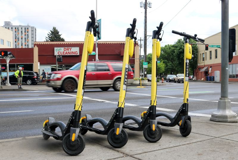PMG PHOTO: ZANE SPARLING - Electric scooters await riders on Northeast Sandy Boulevard in Portland on May 14.