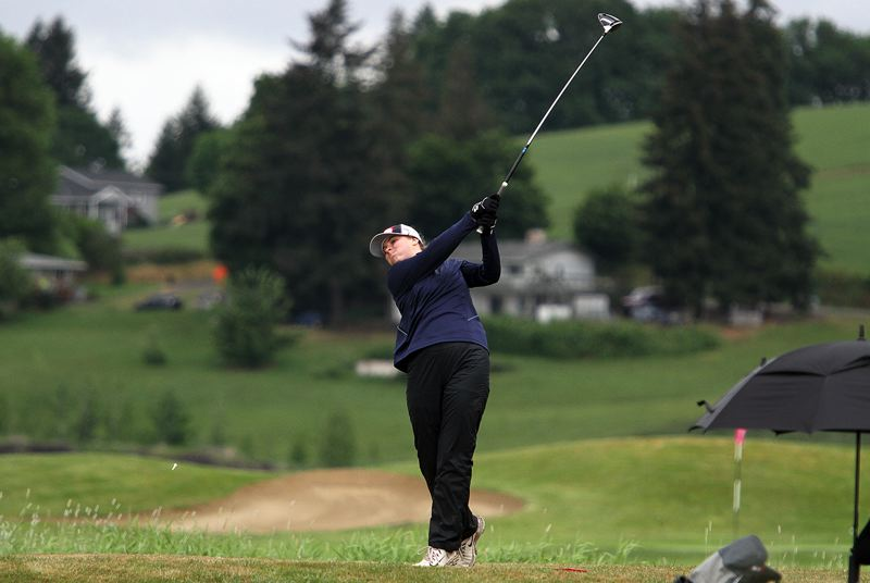 PMG PHOTO: MILES VANCE - Lake Oswego junior Ellie Yarbrough hammers a tee shot during the Class 6A state tournament at Quail Valley Golf Course in Banks on Tuesday, May 14.
