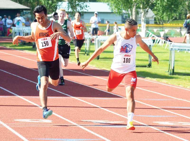 LON AUSTIN - Sophomore Leo Gutierrez finishes the 400-meter run in first place at North Marion High School.