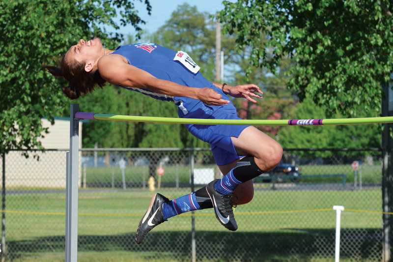 LON AUSTIN - Allen Jackson tied for first  with two other Tri-Valley athletes in the high jump (6-00) at district  May 10-11.