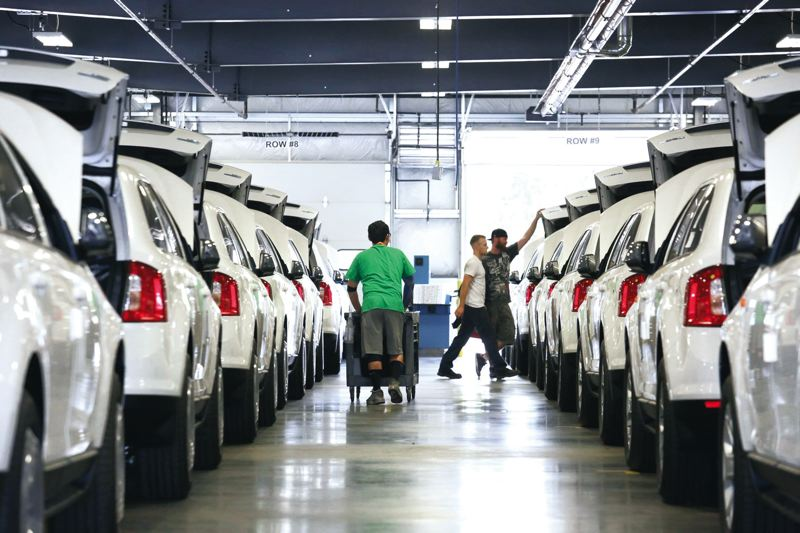 FILE PHOTO - Staff at Auto Warehousings expanded facility at Terminal 6 tweak hundreds of Ford Edge SUVs for export to China.