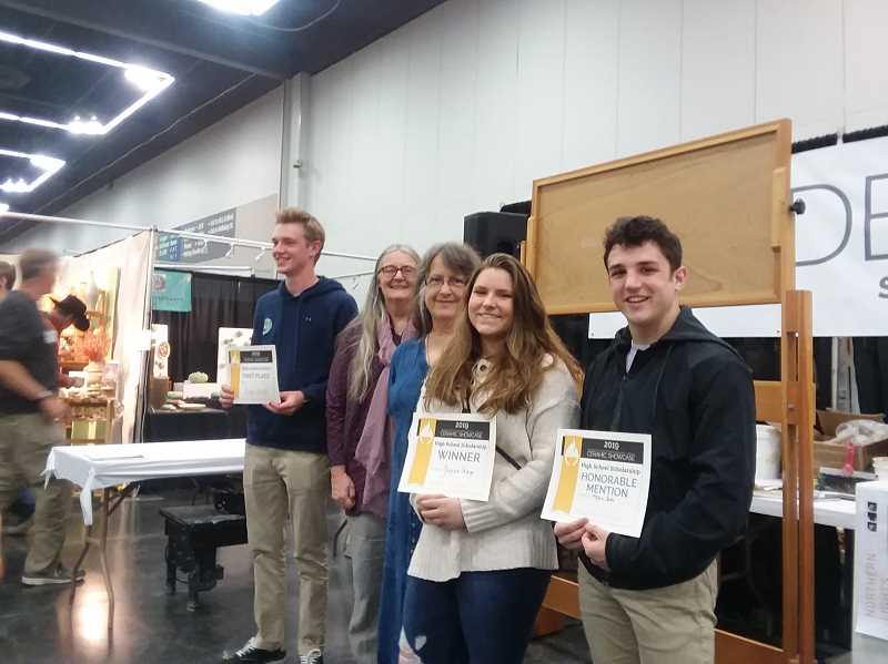 COURTESY PHOTO: ALISSA TRAN - Max Tate (right) and Jaycee Gago (to his left) receive their awards at the Oregon Potter's Association Showcase.
