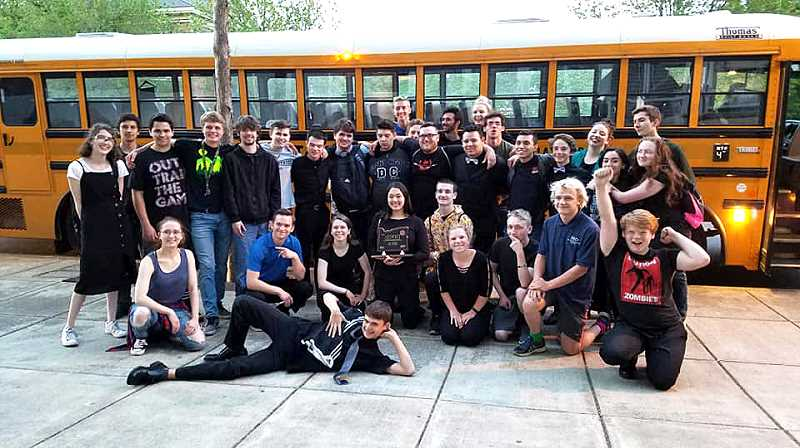 COURTESY PHOTO: AMY CONN - The Molalla band celebrates their win on May 8.
