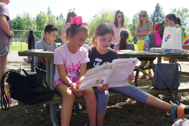 PMG PHOTO: CLAIRE HOLLEY - Lauren French and Channing Emmett browse the paper after school.