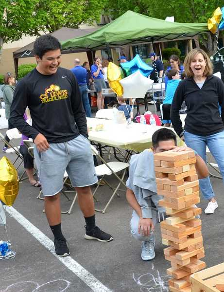 COURTESY PHOTOS  - Family Promise of Tualatin Valley supporters play Jenga at last years Drive In, Sleep Out event. All are invited to participate in this years event scheduled for June 1 through June 2.