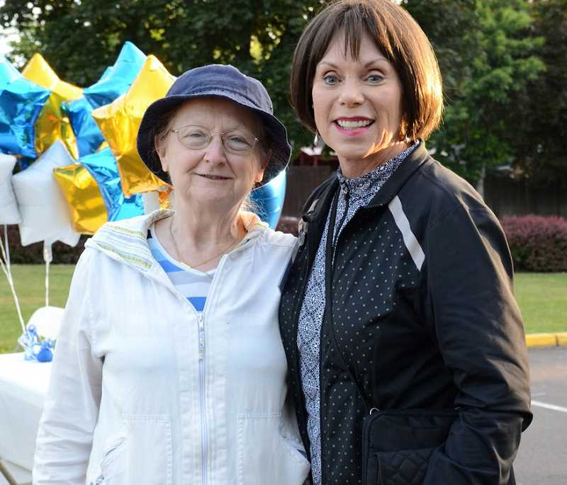 Family Promise of Tualatin Valley Board Chair Judy Nix, right, poses with a FPTV volunteer at last years Drive In, Sleep Out event.