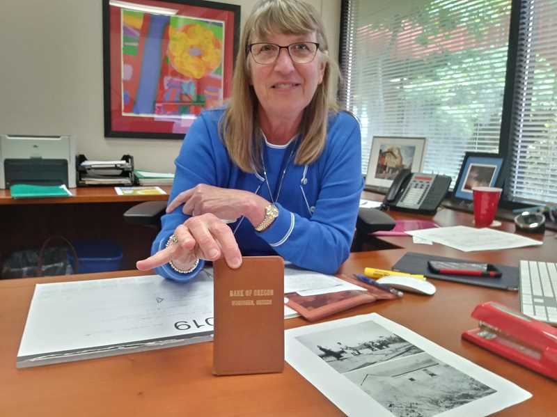 PMG PHOTO: JUSTIN MUCH - Sheryl Southwell displays one of Specialty Polymers original, modest bank books from the early 1970s.