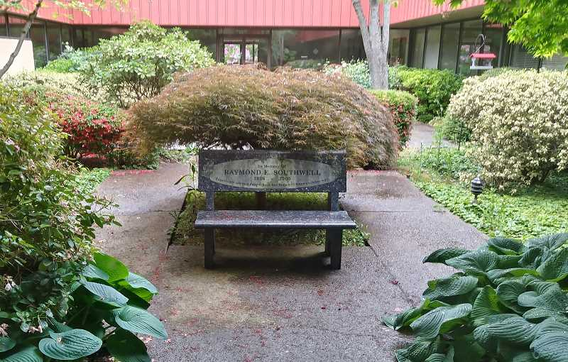 PMG PHOTO: JUSTIN MUCH - A bench in the firms comfortable courtyard memorializes Specialty Polymers founder Raymond Southwell.