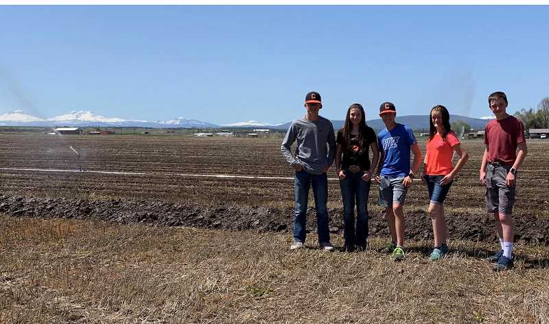 SUBMITTED PHOTO - Culver FFA members at the school field include, from left, Gabe Wilson, Tegan Macy, Brayden Macy, Morgan Brandon and Troy Potampa. Those students, along with multiple others, have helped move irrigation pipe and prepare the field for planting and irrigation.