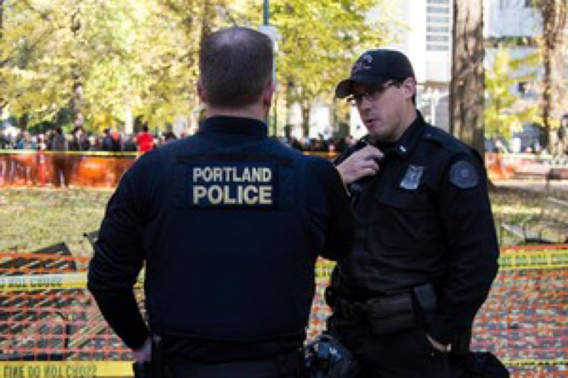 BRADLEY W. PARKS/OPB - Portland police Lt. Jeff Niiya, right, with the police bureau's rapid response team at a protest in downtown Portland in 2017.