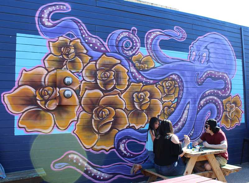 HOLLY M. GILL/MADRAS PIONEER - Artist Juan Leon (not pictured) created an octopus mural on the north wall of the OK Barbershop — a public art project that makes blank walls more interesting, a key idea expressed to the city by consultant Michele Reeves.