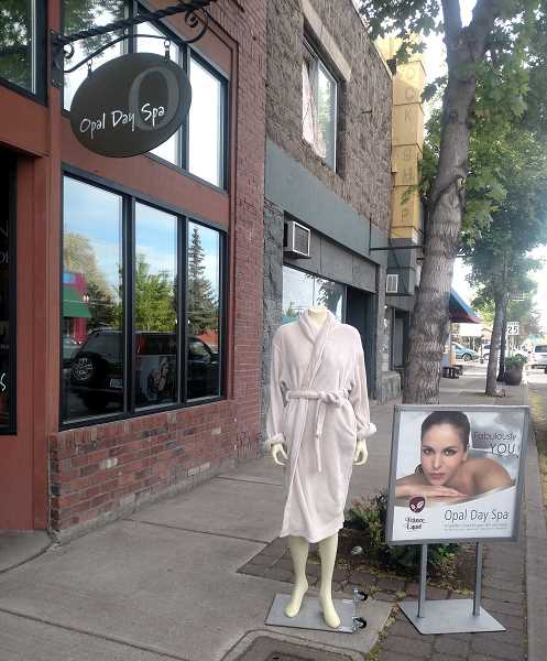 SUBMITTED PHOTO - After a recent meeting on making the downtown more inviting, Opal Day Spa owner Sarah Gannon went straight to her shop on Fifth Street and made changes to make the shop more visible.