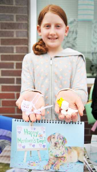 GRAPHIC PHOTO: GARY ALLEN - Devianna Gerr, 10, shows off some of the crafts she and her classmates are selling to raise money for the Newberg Animal Shelter.