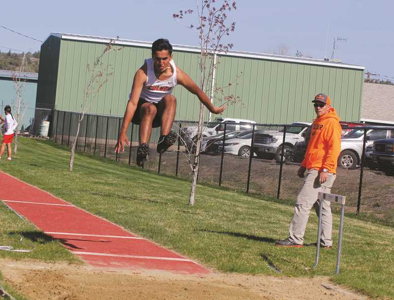 STEELE HAUGEN - Cesar Orozco ties with teammate Kash Michael, placing first in the long jump (19-10.75).
