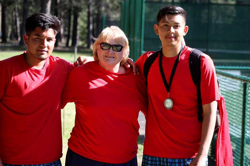 STEELE HAUGEN - Tony Giron (left) and Esteban Gomez (right) stand with head coach Margaret Kincaid (middle), after the doubles team placed second at the district tournament May 9.