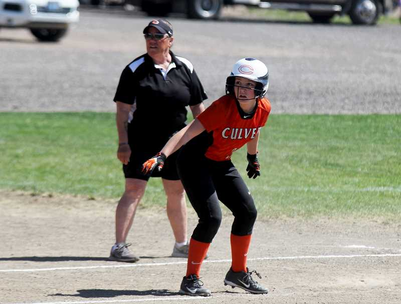 STEELE HAUGEN - Emma Hayes takes a lead off at third base, ready to score.