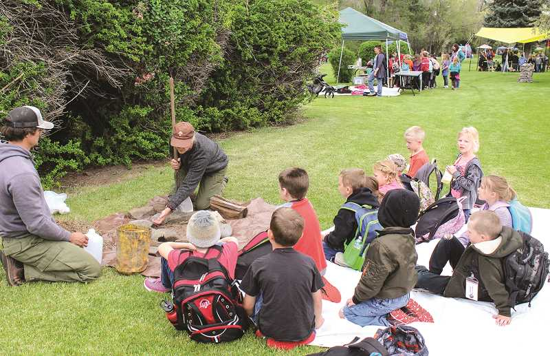 JASON CHANEY/CENTRAL OREGONIAN  - Ochoco National Forest personnel lead a campfire safety lesson for first graders in Marilee Smith's Barnes Butte Elementary class.