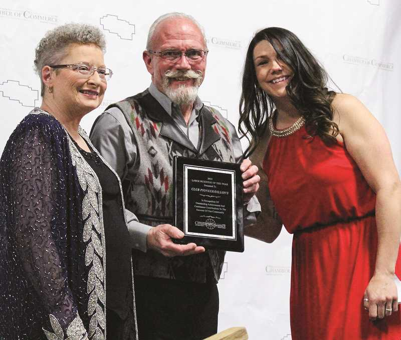 JASON CHANEY/CENTRAL OREGONIAN - Dillon's Grill and Club Pioneer owners Jim and Donna Roths accept the 2018 Large Business of the Year award from Prineville-Crook County Chamber of Commerce board member Sheena York during the chamber banquet last month.