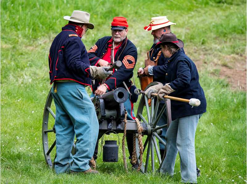 PHOTO BY LON AUSTIN - Union soldiers prepare a cannon during a battle at last year's House on the Metolius Civil War Reenactment. This year's history event is May 18 and 19, near Camp Sherman.