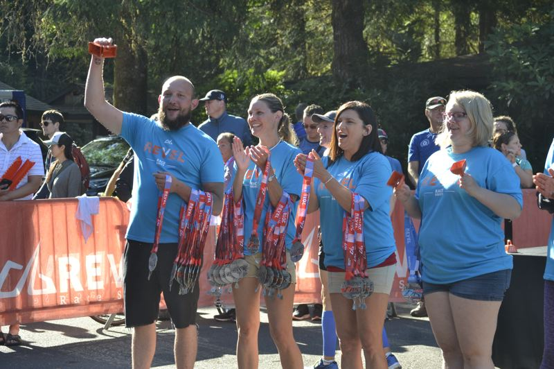 POST PHOTO: BRITTANY ALLEN - Volunteers from groups like Sandy's Helping Hands, the Hoodland Women's Club and the Mt. Hood Chamber of Commerce were among those helping out at the 2018 REVEL Mt. Hood Marathon. All are welcome to return.