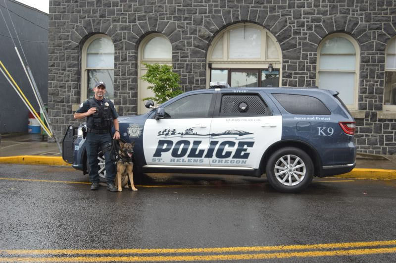 PMG PHOTO: NICOLE THILL-PACHECO - St. Helens Police Department Officer Jon Eggers and K9 Officer Ryder pose for a photo in front of one of the citys new police vehicles. The K9 vehicle is equipped with standard safety features, including amenities specifically for the K9 officer.