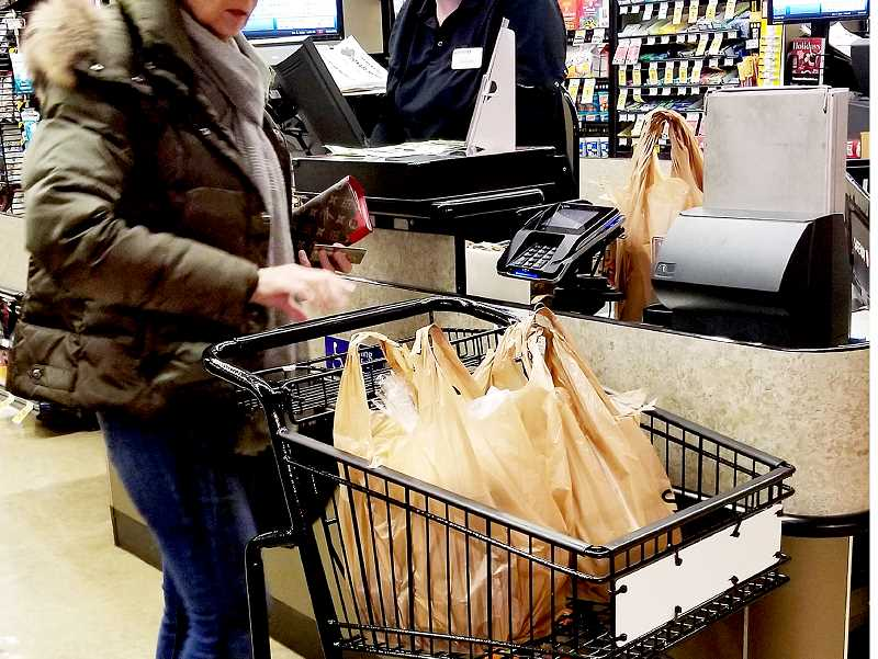 PMG FILE PHOTO - A number of cities in Oregon have already banned the use of single-use plastic bags in their stores.