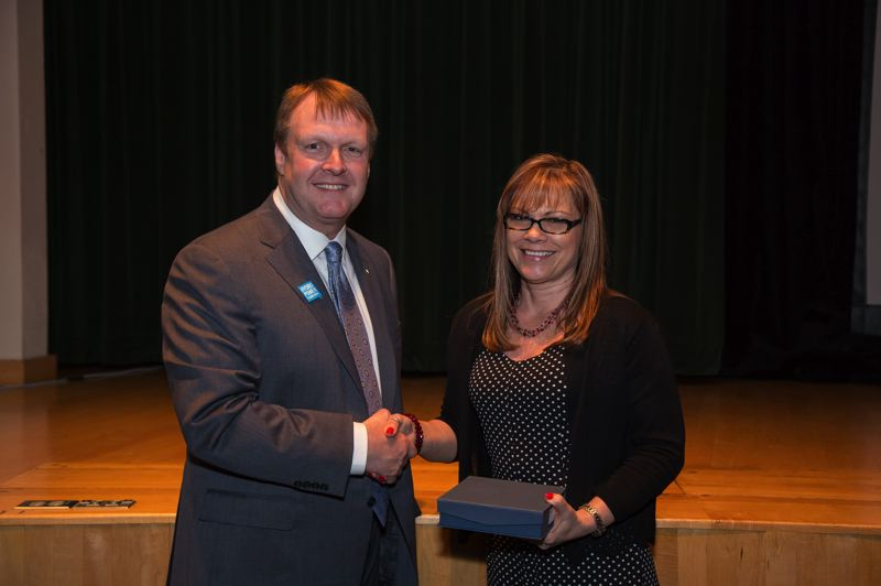COURTESY PHOTO: BPA  - Elliot Mainzer of Bonneville Power Administration presented Fairview resident Tina Horsey with its Unsung Hero Award at the agencys 2019 Administrators Excellence Awards.